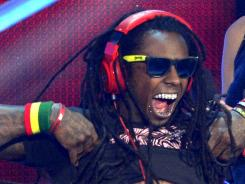 Lil Wayne accepts the award for best hip-hop video at Thursday's MTV Video Music Awards.