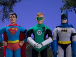 Superman, Green Lantern and Batman attend the funeral of a fallen comrade in the Robot Chicken DC Comics Special.
