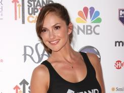 Actress Minka Kelly stops on the red carpet at the Stand Up to Cancer benefit Friday at the Shrine Auditorium in Los Angeles.