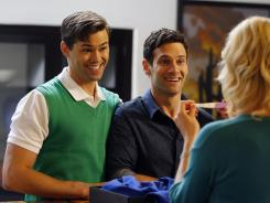 Dads-to-be: Gay couple Bryan (Andrew Rannells, left) and David (Justin Bartha) hire a single mother as a surrogate to carry their baby.