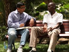 Author/director Dinesh D'Souza interviews George Obama, the president's half brother, in '2016: Obama's America,' a conservative documentary based upon D'Souza's book.