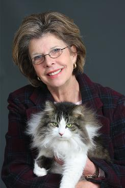 Sharon L. Peters holds her cat Gus in Colorado Springs.