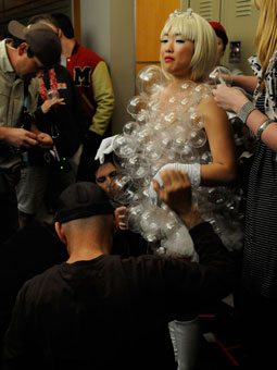 The crew engineers Tina's (Jenna Ushkowitz) bubble dress before the filming of a scene for the Lady Gaga episode.