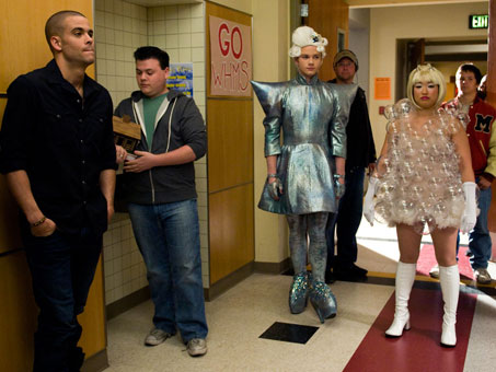 Colfer and  Ushkowitz, decked out in costume, wait to rehearse a scene. Mark Salling, who plays Puck, is at the left.