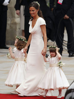 Kate's sister and bridesmaid Pippa Middleton walks down the aisle with the flower girls.