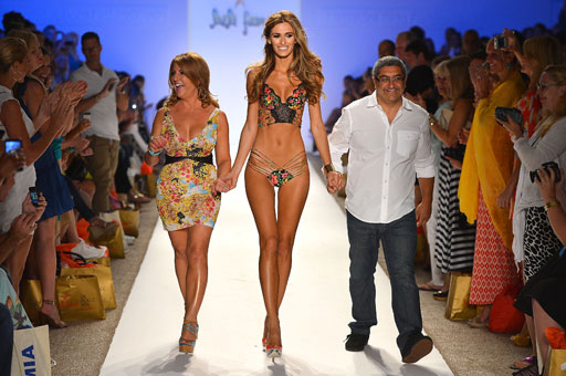 Designers Lourdes Hanimian and Augusto Hanimian walk the runway with their model during the Luli Fama presentation.
