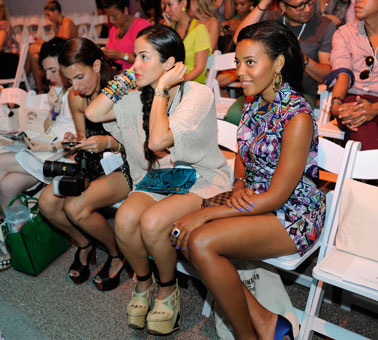 Angela Simmons, right, joins friends in the front row at the Mara Hoffman 2013 resort swim collection.