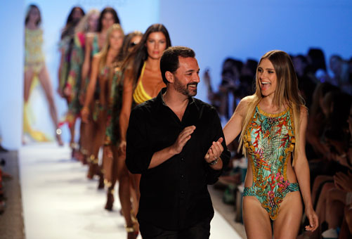 Cia Maritima designer Benny Rosset, center, walks the runway with models wearing his collection.