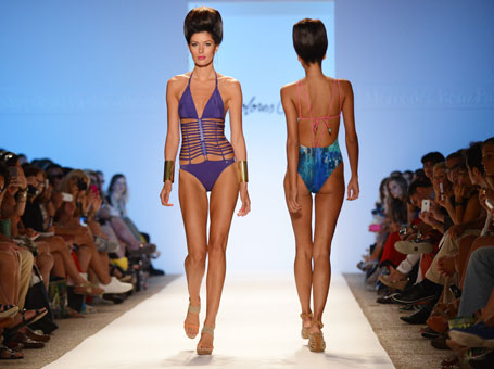 Models show more one-piece designs in the Dolores Cortes swimwear show Friday.