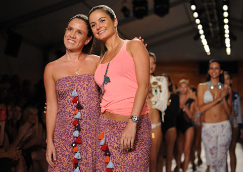 Designers Mariana Hinestroza and Catalina Alvarez acknowledge the Mercedes-Benz Fashion Week audience during their Agua Bendita show.