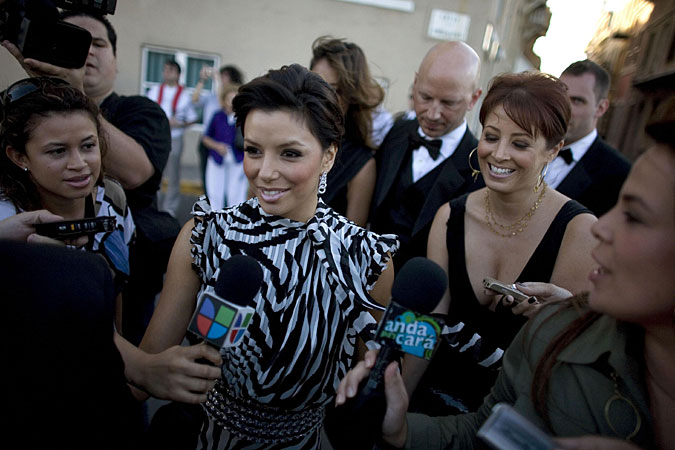 Eva Longoria chats with Puerto Rican reporters upon arriving for the wedding