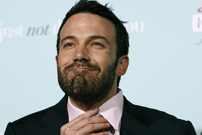 He's Just Not That Into You co-star Ben Affleck straightens his tie so he'll ...