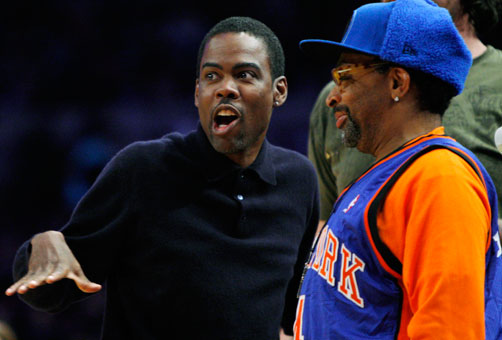 Chris Rock, left, talks to Spike Lee during the Knicks-Trail Blazers game.