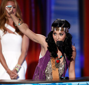 Katy Perry accepts the award for