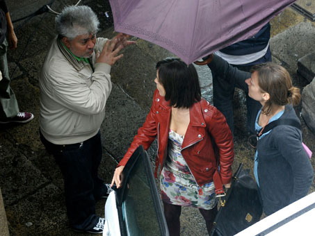 Director Pedro Almodovar, left, talks with actress Elena Anaya, center, on the set of his new film, La piel que habito (The Skin I Live In,) in Santiago de Compostela, Spain, on Monday.