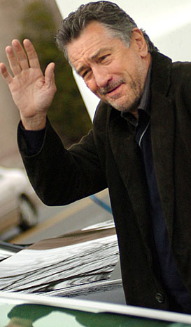 Actor Robert De Niro waves to fans as he shuffles from his trailer to the ...