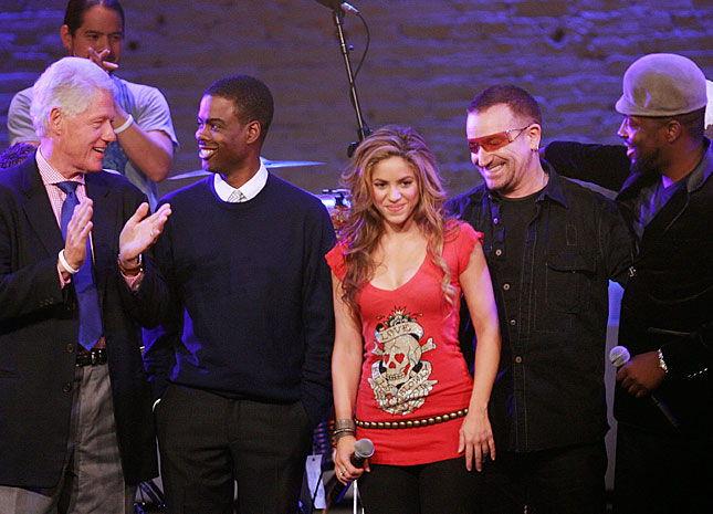 Former president Bill Clinton corrals Chris Rock, left, Shakira, ...