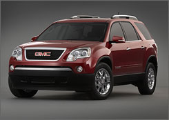 The GMC Acadia can seat up to eightpeople. Its third-row seat folds onto the floor.