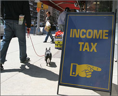 A sign outside a real estate office advertises that they also do tax preparation.