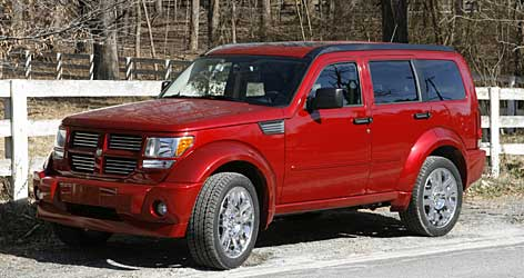 Dodge Nitro, a small SUV about the size of a Nissan Xterra, has a grille that tries too hard to look fierce, but otherwise it's a nice package with personality.