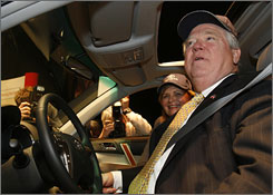 Gov. Haley Barbour of Mississippi and his wife Marsha in a Toyota Highlander provided for Tuesday's announcement ceremony.