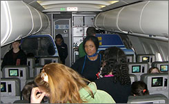 A flier's cellphone camera shows restless passengers during an 8-hour wait aboard JetBlue Flight 751 on an icy Feb. 14 at New York's JFK airport.