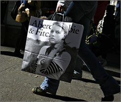 A customer carries an Abercrombie & Fitch shopping bag in New York on Feb. 21.