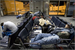 Passengers sleep in a Denver concourse Dec. 21 after a blizzard left the airport snowbound.