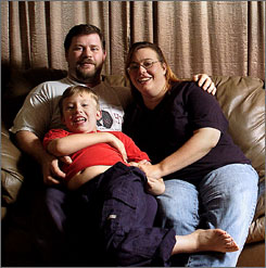 T.J. and Lela Robichaux of Shreveport, La., and son Trent, 8. For more than year Trent, who has autism, has been uninsured because the family earns too much to qualify for Medicaid.