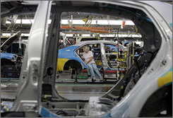 Toyota cars move along an assembly line at a Toyota plant in Georgetown, Ky.