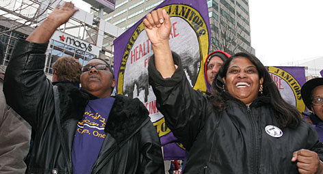 Linda Watson, left, and Lauressie Tillman recently took part in a labor rally at Fountain Square in downtown Cincinnati to highlight efforts to support service sector workers such as janitors and hotel workers.