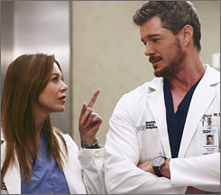 Ellen Pompeo and Eric Dane star in 'Grey's Anatomy.' Ad buyers and sellers are trying to measure how ads are viewed during such shows.