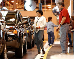 Operations technicians Maxine Gilmore and Dwayne Manning work on the Saturn Vue final inspection line at the Saturn plant in Spring Hill, Tenn.