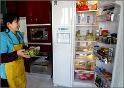 Liu Yonghua, 41, earns $153 a month, but her Whirlpool refrigerator cost up to $2,500.