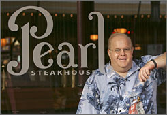 Florida business fraud investigators haven't been able to reach boy band mogul Lou Pearlman, who left the country in January. He is seen here at his Orlando restaurant in October.
