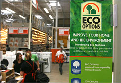Signs in an Atlanta Home Depot advertise the Eco Options label, which marks products that a third party has deemed environmentally friendly.