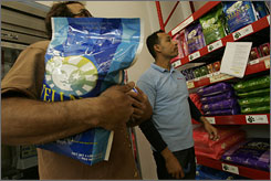 Seeking a substitute: Pet Food Express manager Ernie Tovar, right, advises a San Francisco pet owner.