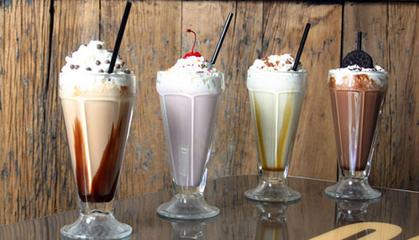 Milkshakes at BLT Burger show the trend toward creative milkshakes. The two at either end are even spiked with alcohol (the coffee-themed Go-Go, left, and Oreo-flavored Night Rider, right).