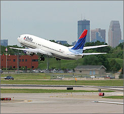 Wall Street is generally bullish on Delta, which is expected to emerge from bankruptcy at the end of the month. (Here, a Delta jet lifts off from Minneapolis/St. Paul.)