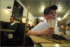 Matthew Knight, 12, enjoys a milkshake at BLT Burger in Manhattan.