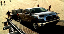 A Toyota Tundra pulls 10,000 pounds up a ramp in the carmaker's real-deal ads.