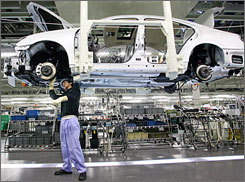 A worker at a Toyota plant in Miyata, Japan, helps assemble a Lexus.