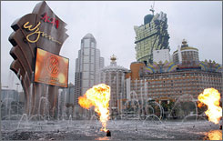 Programmed flames erupt from the fountains at the Wynn Casino in Macau last month.