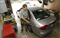 Jeff Church fills up his Honda Civic GX with natural gas at his San Dimas, Calif., home.