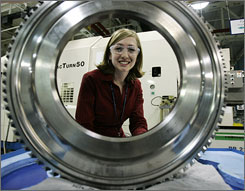 Nikki McMullen, 25, is among 50 employees chosen for an accelerated management program at Rolls-Royce, the world's second-largest aircraft engine maker. She oversees a five-member team, gives PowerPoint updates to executives and is helping design a factory in England.