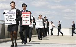 Denise Duke, front, marches with other Northwest employees during an informational picket on April 19 in Detroit.