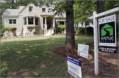 A house on Venetian Drive in Atlanta is shown May 22, 2007. It is one of the houses that Atlanta businessman Sam Leccima used in a reality TV series 'Flip This House' and is presently on the housing market.