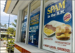 Huge poster advertises Spam for breakfast in a Honolulu Burger King.