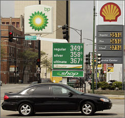 Is cheaper gas better? Rising prices are shown on signs at two Chicago stations in May.