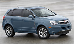GM hopes to develop a plug-in version of this 2008 Saturn Vue Green Line SUV hybrid as soon as 2010.